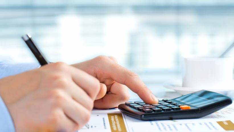20150706190223-mr-finance-fix-it-businessman-calculator-calculating
